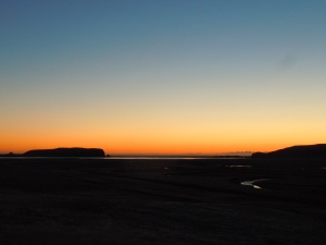 The black sand beaches of Vik at sunset.