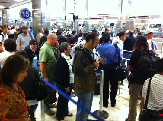 A typical line for immigration and customs. Photo courtesy of Erik Allen via Flickr.